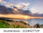 sunbeam through clouds at byron ... | Shutterstock . vector #1218427729