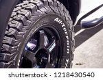 Small photo of BANGKOK, THAILAND - OCTOBER 31, 2018; close up of BFGoodrich All-Terrain 4WD tyre features tougher sidewall rubber. The tyre uses split & bruise resistant sidewall rubber fit for light truck and SUV.