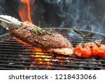steak on the grill with flames... | Shutterstock . vector #1218433066
