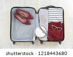 open suitcase with female... | Shutterstock . vector #1218443680