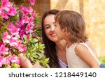 daughter with mother near the... | Shutterstock . vector #1218449140