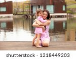 mother and daughter are... | Shutterstock . vector #1218449203