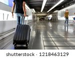 woman drag luggage on escalator ... | Shutterstock . vector #1218463129