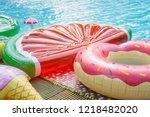 pink floating donut  water... | Shutterstock . vector #1218482020