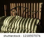 a bed with pillows and... | Shutterstock . vector #1218507076