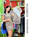 happy elegant woman shopping in clothing store - stock photo