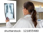 woman doctor looking at x ray... | Shutterstock . vector #121855480