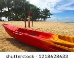 red boat on the beach  ocean | Shutterstock . vector #1218628633