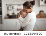 mother comforts a sad baby  mom ... | Shutterstock . vector #1218644920