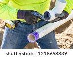 Plumber Applying Pipe Cleaner ...