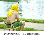 the guy sits on a stool and...   Shutterstock . vector #1218869083