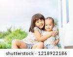little sister hugging her baby... | Shutterstock . vector #1218922186