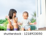 little sister playing with her... | Shutterstock . vector #1218923050