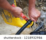 leaked poly pipes are being...   Shutterstock . vector #1218932986