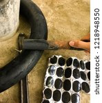 Small photo of This picture show use sandpaper to polish the tires in recapitulation.