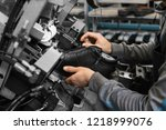 man use special machine tool... | Shutterstock . vector #1218999076