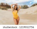 sexy model in yellow swimsuit... | Shutterstock . vector #1219012756