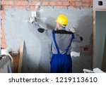 workman is plastering the wall... | Shutterstock . vector #1219113610
