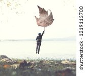 man flying with a leaf ... | Shutterstock . vector #1219113700