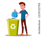 young guy throwing trash bags... | Shutterstock .eps vector #1219122703