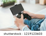 child hands with game... | Shutterstock . vector #1219123603