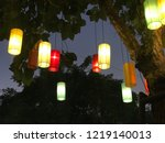 color lanterns hanging on tree... | Shutterstock . vector #1219140013