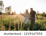 charming expecting couple walks ... | Shutterstock . vector #1219167553