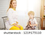 doctor and patient at home....   Shutterstock . vector #1219175110