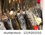 jeans hanging on the rail in... | Shutterstock . vector #1219201510