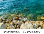 sea water and pebbles on a... | Shutterstock . vector #1219265299