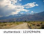 scenic drive on dirt road... | Shutterstock . vector #1219294696