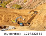 the excavators are digging and... | Shutterstock . vector #1219332553