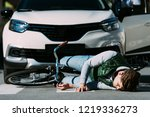 injured young cyclist lying... | Shutterstock . vector #1219336273