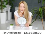 woman cleaning face with white... | Shutterstock . vector #1219368670