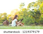 young woman reading a book in... | Shutterstock . vector #1219379179