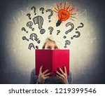 young pensive woman hiding... | Shutterstock . vector #1219399546