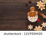 gingerbread man bathing in cup... | Shutterstock . vector #1219504420