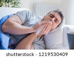 sick man blowing nose and... | Shutterstock . vector #1219530409