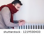 man feeling very cold at home... | Shutterstock . vector #1219530433