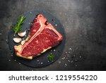t bone beef steak on black... | Shutterstock . vector #1219554220