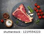 t bone beef steak on black... | Shutterstock . vector #1219554223