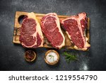 raw meat beef steak. black... | Shutterstock . vector #1219554790