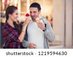 funny couple with ice cream in... | Shutterstock . vector #1219594630