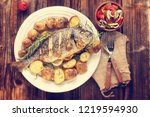 grilled dorada fish with... | Shutterstock . vector #1219594930