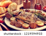 grilled dorada fish with... | Shutterstock . vector #1219594933