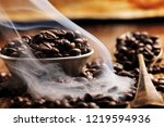coffee beans on rustic steel... | Shutterstock . vector #1219594936