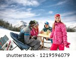smiling young girl with family... | Shutterstock . vector #1219596079