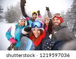 cheerful friends with hands up... | Shutterstock . vector #1219597036