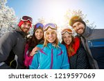 happy smiling friends on winter ... | Shutterstock . vector #1219597069