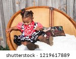 little girl playing in a chair | Shutterstock . vector #1219617889